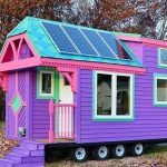Movable And Colorful Cabin With Some Pieces O F Solar Panels On Roof