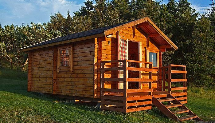 Off the grid home designs homesfeed for Wood cabin homes