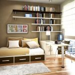 a bed furniture with under storage the arrangements of floating bookshelves a corner desk in white a tiny metal legs chair a small fury rug wood floors