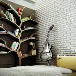 a cool media room design with white brick wall accent and guitar and white furry area rug and stunning tree shaped bookshelf