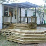a mobile house with porch and wood railing in shabby look
