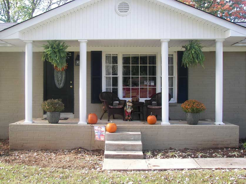 A Ranch Home Style With Simple Front Porch Without Railing System A Pair Of  Darker Rattan