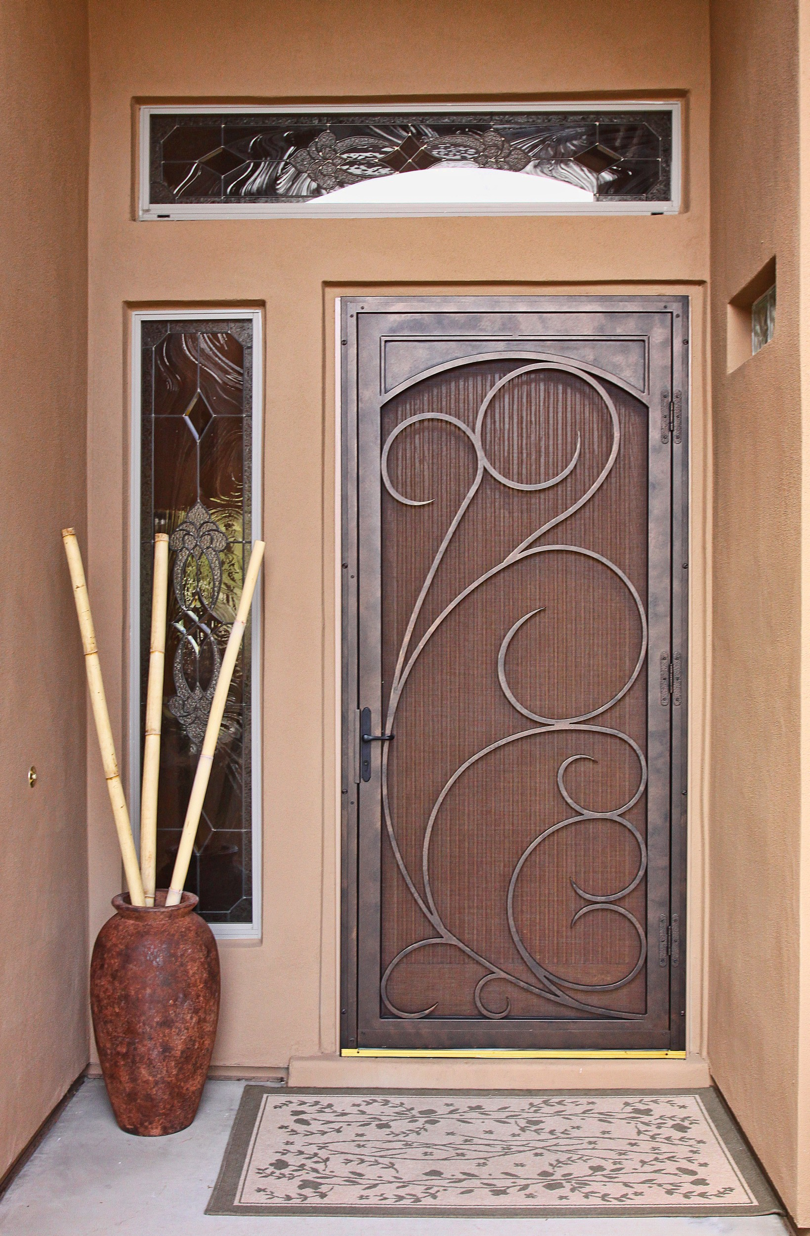 a security door with single sidelight feature but without doors transparent screen a decorative vase as - Unique Home Designs Security Door