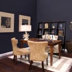 A Workstation With Three Chiars A Small Cotton Rug Dark Stained Wood Planks Floors Two Glasses Decorative Items Cool Mirrors With Beautiful Frames Lend Shelves Unit For Decorative Items