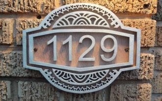 address home number with pretty art deco house numbers with wooden material plus natural brick pattern wall