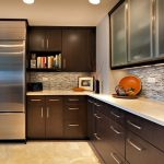 adorable L shaped kitchen design with modern kitchen set and stainless steel storage idea with brown cabinetry with mosaic backsplash and cashmere white granite