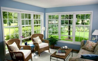 adorable blue sunroom design with rattan chairs and unique floral sofa design with metal coffee table and glass windows