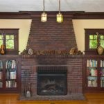 adorable-cool-classic-craftman-fireplace-with-brick-concept-in-brown-coloring-with-nice-bookshelf-on-the-left-and-right