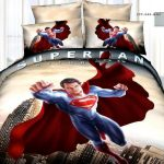 adorable kids fun bed sheet design with playful pattern of superman on the quilt and pillows with unique floor lamp