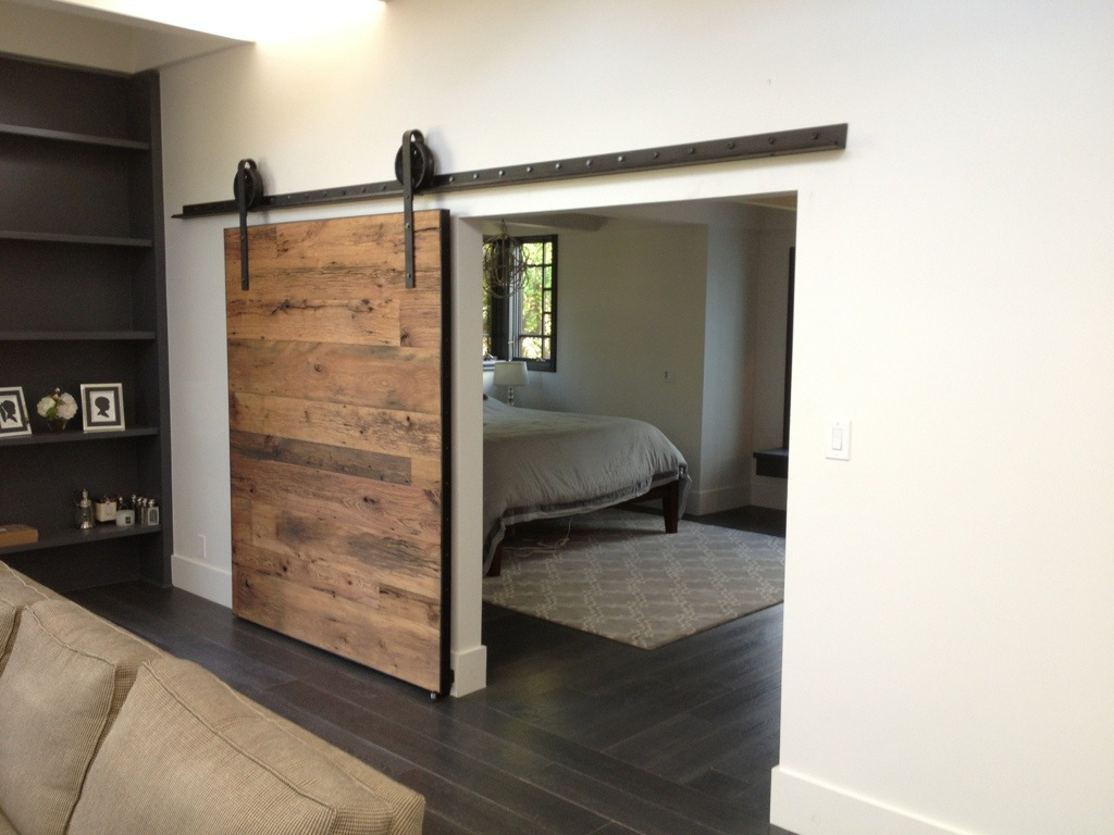 Adorable Master Suit Bedroom Design With Wooden Barn Door Design With Black  Metal Rod Sliding On