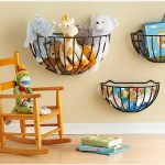 Adrable Half Circle Black Metal Hanging Stuffed Animal Design In Various Size Of Three With Rocking Chair Beneath Cream Wall