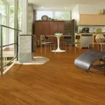 Vinyl flooring that looks like wood by Armstrong in this living area.