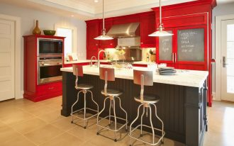 amazing red and spacious kitchen design with white ceiling and modern lighting above white black kitchen island with black metal stools with cashmere white granite