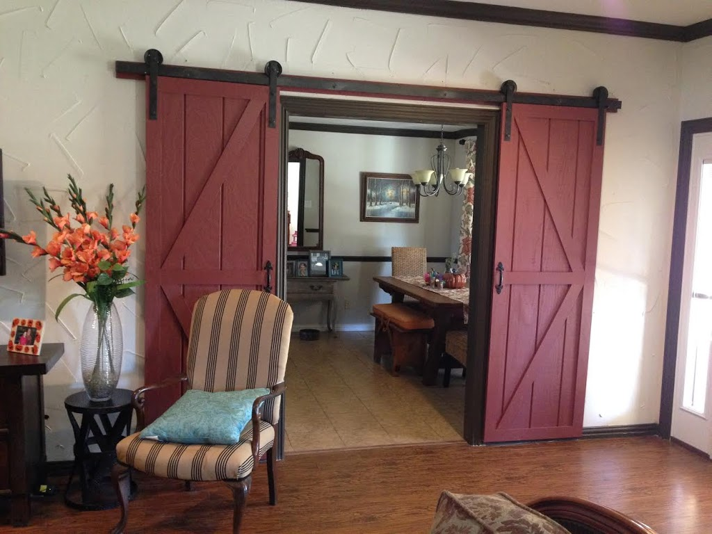 Amazing Red Barn Door Design With Black Rustic Metal Rod Idea Stripe Patterned Seating Aside