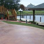 amazing reddish tone outdoor flooring idea with curve style aside lake with roof and porch aside big tree with wooden staircase