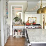 amazing white kitchen design with gray storage and golden pendants above white marble countertop os gray island