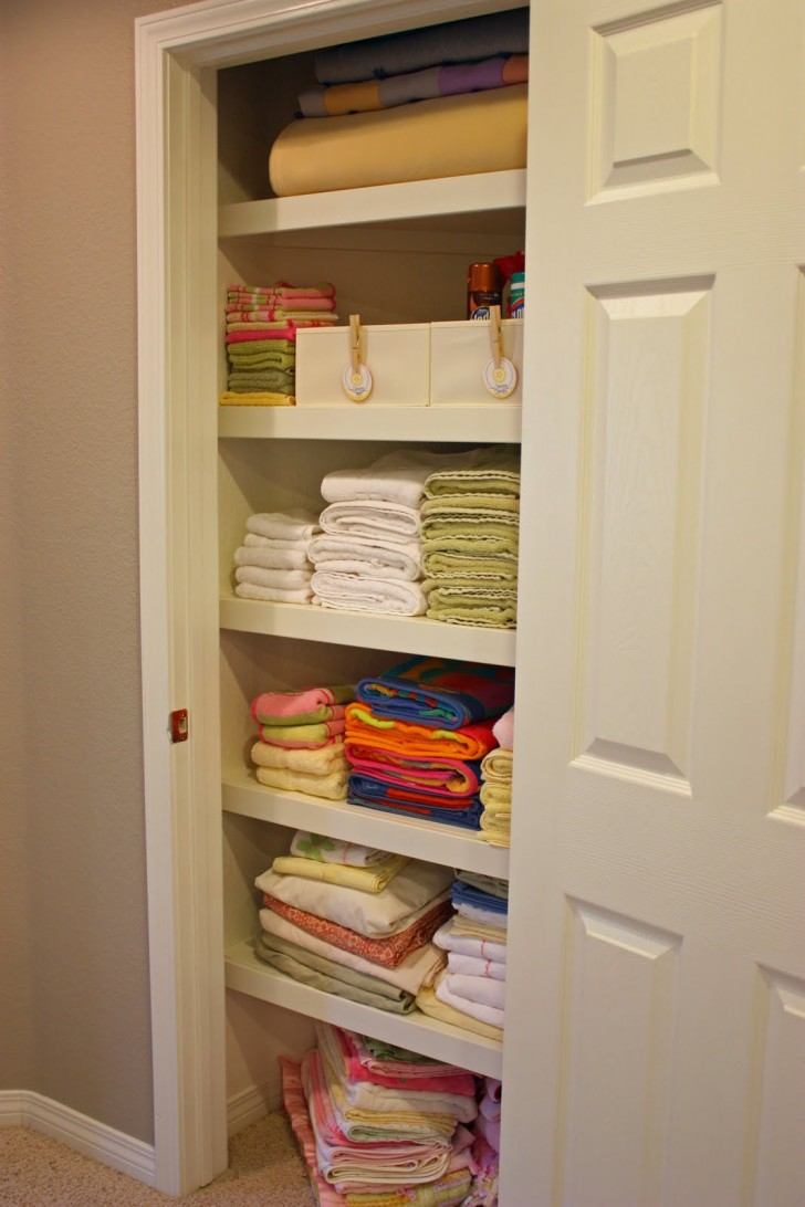 awesome cool nice great linen closet organizer with large spce concept with white door and colorful linens