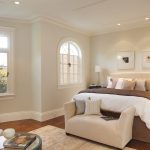 baseboard trim styles for modern bedroom ideas with comfy bed and wooden floor plus rug and beautiful glass window and sofa and wooden nightstands