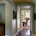 baseboard trim styles in white paired with turqouise painted wal and wooden floor plus white wooden door