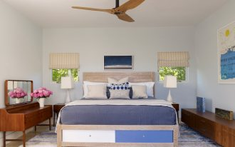 battery operated ceiling fan which is decorated in modern bedroom decoration with comfy bed and nightstands plus table lamps and modern rug