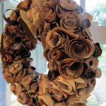 beautiful brown pottery barn wreaths like rose hanging on glass front door