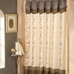 beautiful combination of cream brown and navy blue colors of bed bath and beyond shower curtain with floral pattern aside gray wall and round metal table