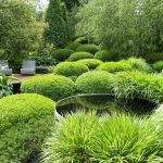 beautiful landscape by Better Homes and Gardens with a pair of white chairs