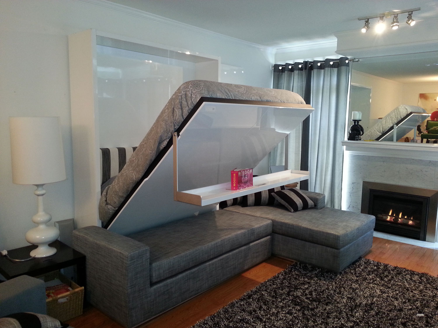 Bed That Folds Into Wall In Combination With Gray Sectional Sofa With  Striped Cushion And Soft