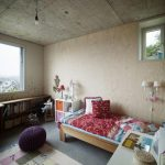 bedroom decoration with under window bookcase plus wooden bed frame and wall scones and white desk plus rug and stool