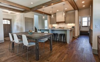 best floors for kitchens with hardwood floor and kitchen bar with jar lighting fixtures plus wooden stool and dining room with wooden table plus comfy white chairs