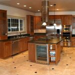 best floors for kitchens with tiles and wooden cabinets and sink plus hanging pendan lamps plud granite countertop