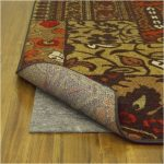 best rug pads for hardwood floors with anti slip pad under the floral motif rug for home interior