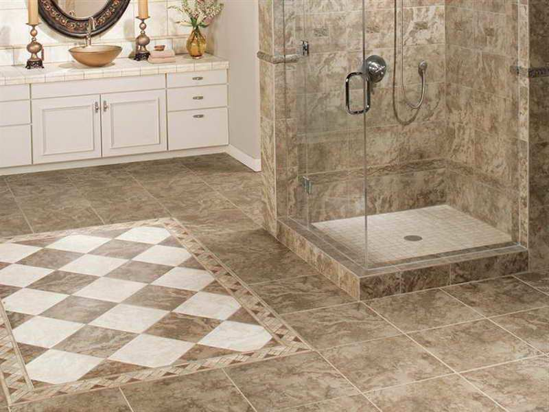 best tile for shower floor in luxury bathroom with glass wall and wooden vanity units - Luxury Tile Showers