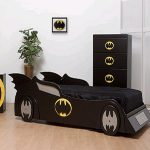 black car beds for toddlers in batman theme with chest of drawers and nightstand and greenery plus wooden laminated floor
