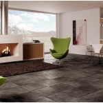 black washed style tiles floor system for contemporary open space with a pair of green chairs modern minimalist fireplace mantel in white black wool carpet a set of dining furniture