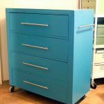 blue modern wood filing cabinet ikea with floor drawers and aluminum handles and wheels for home office ideas combined with wooden laminate floor