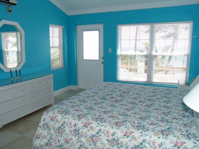 blue ocean tone color for bedroom wall glasss window with trims and white  window blinds minimalist. What Color should I Paint My House    HomesFeed