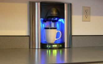 brew express plumbed coffee maker built in wall with kitchen countertop and timer plus power button for home kitchen