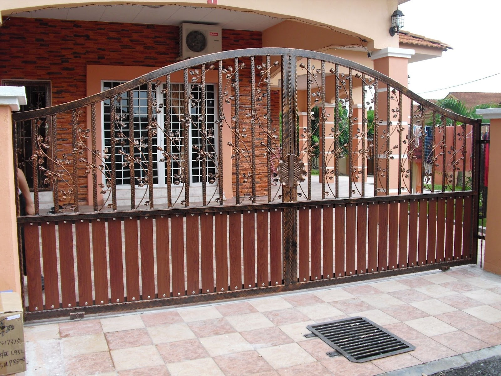 Brown Stained Iron Main Gate For Home With Vertical Wood Planks In The  Bottom