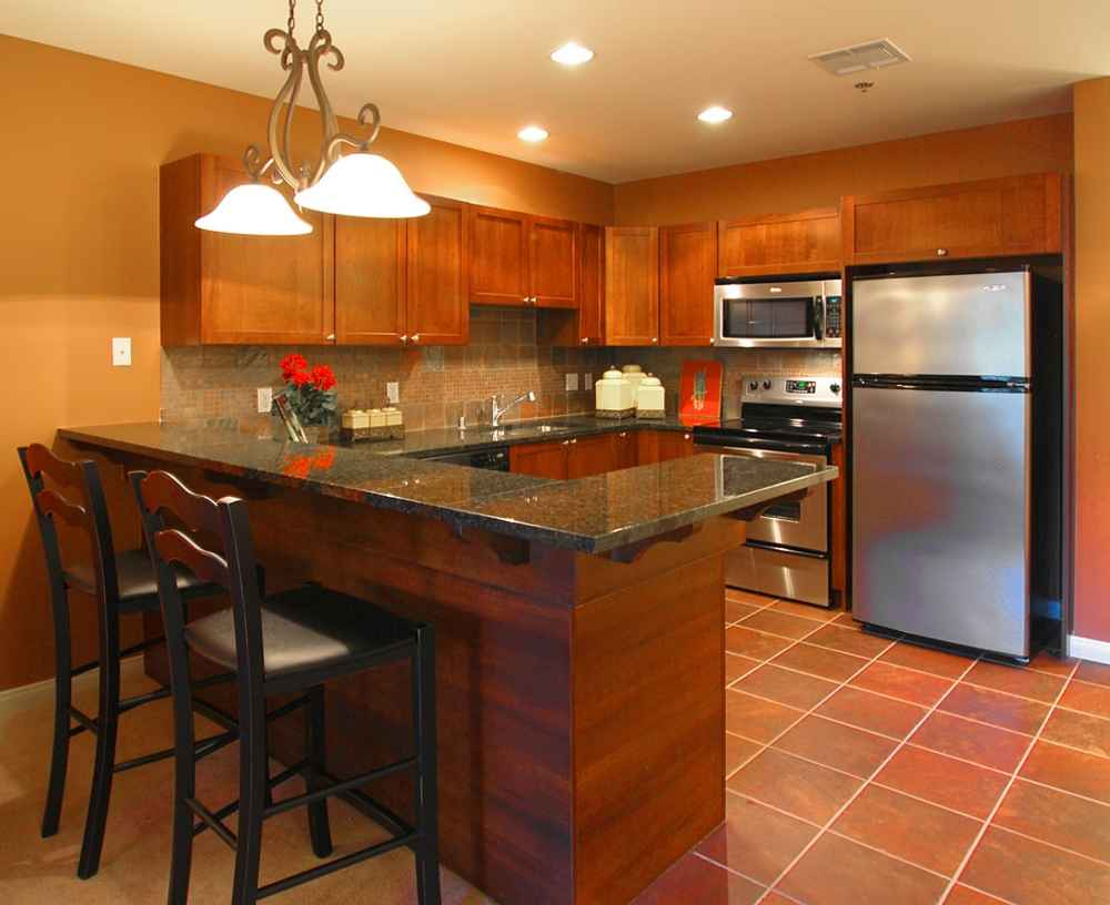 Cheap Countertop Options On Wooden Cabinets Plus Kitchen Island With Bar  Chairs And Tile Floors And