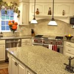 cheap countertop options with granite and sink and pendant lamps and white wooden cabinets and refrigerators and stove plus flower vase