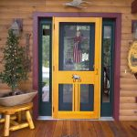 chic and fun colored screen door with transparent glass panel on top and water insect screen on bottom and also yellow molding sidelight features in maroon frame  wood planks floors logs wall system