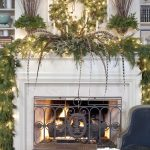 christmas decorations for mantels fireplace ideas with green garlands and romantic string light plus wreath and candle holders plus twig vases