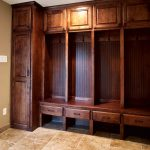 classic mudroom storage units in solid wood dark finishing combined with drawers and cabinets plus tile flooring and glass door home furniture