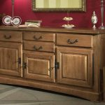 classic wooden what is a sideboard with drawers and decorative plates and candleholders plus ceramic and framed mirror plus wooden seating