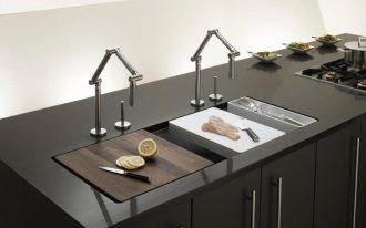 classy trough sink for kitchen ideas with unique faucet and glossy black countertops and cabinets plus gas stove