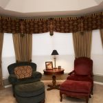 classy window coverings for large windows with brown curtain and drapery plus blinds combined with comfy reading chairs with ottomand and round wooden table