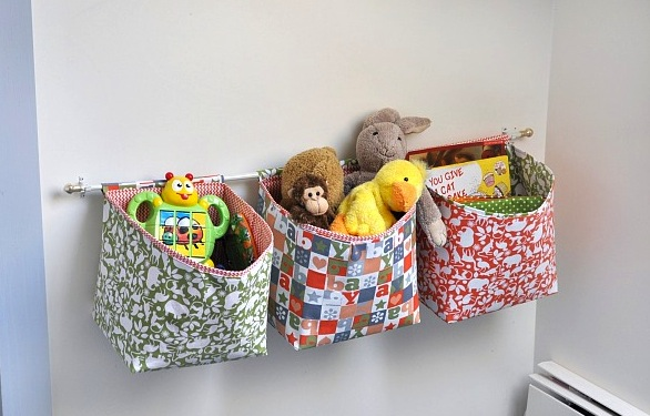 Colorful Patterned Three Section Hanging Stuffed Animal Design In  Horizontal Model Beneath White Wall Like Sacks