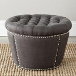 comfortable round tufted black ottoman file storage design with white accent upon fabric area rug