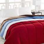 comforter in red white blue and brown color options white wool carpet black wood bedside table with modern white table lamp